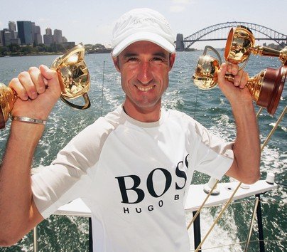 SYDNEY, NSW - DECEMBER 13:  Jockey Glen Boss shows off his three Melbourne Cup trophies aboard the Hugo Boss yacht during the 2005 Big Boat Challenge held on Sydney Harbour December 13, 2005 in Sydney, Australia. Glen Boss sailed with the Hugo Boss crew after he became the newest Hugo Boss ambassador.  (Photo by Chris McGrath/Getty Images)